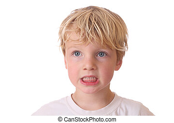 Angry boy - Portrait of an angry young boy on white...