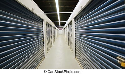 Storage Facility. Corridor. - Walking with a handheld...