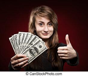woman showing fan of money