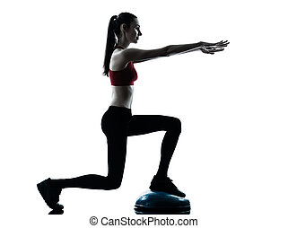 woman exercising bosu balance ball trainer - one caucasian...