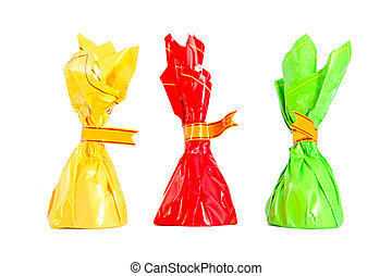 Three isolated colorful candies - red, green, yellow