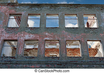 Destroyed building - the window of a ruined house in the...