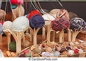 balls of wool - colored balls of wool on wooden rustic...