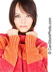 brunette woman in a red-orange wool sweater