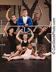 Ballet Class Portrait - Cute group of girls with male...