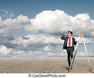 Businessman in search of business in a desert