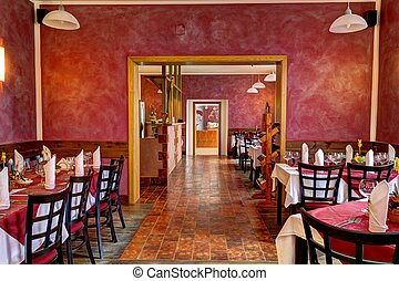 restaurant interior in red, adorned with tables
