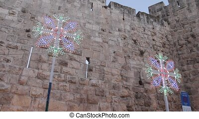 Festive lights - Old Jerusalem wall decorated with festive...