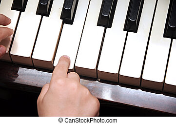 Piano playing hands of a child
