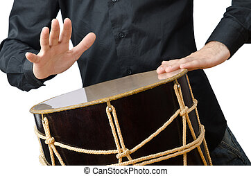 Drummer with drum playing on white