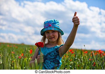 Pretty blond girl with red flowers - young blond girl with...