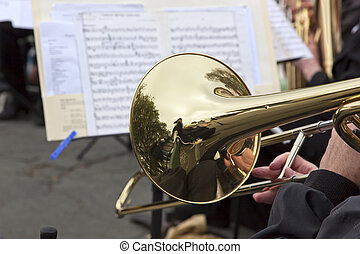 Playing the Slide Trombone - Man playing the slide trombone,...
