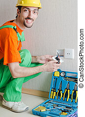 Electrician repairman working in the house