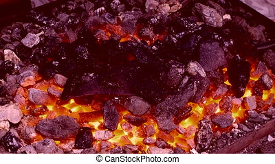 Throw the heat - Embers on the hearth are ready to work a...