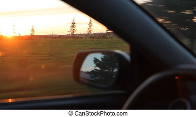 Sunset drive. - Driving in the country, with sun going down....