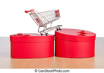 Giftbox and shopping cart on white