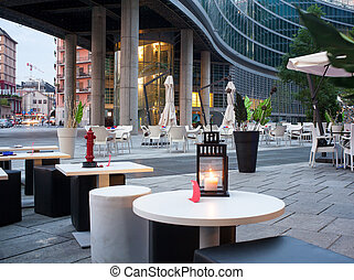 Outdoor pub - Little tables and stools in a outdoor pub