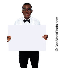 Smiling business representative holding whiteboard - Smiling...