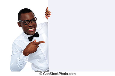Black man pointing at blank placard - Handsome black man...