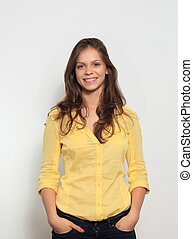 pretty young woman smiling on white background