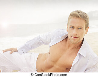 Young happy man - Succesful young good-looking guy on the...