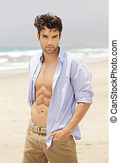 Good looking man - Good-looking man on beach with open shirt