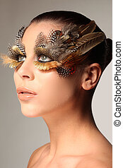 Decorative feather make-up like the wing of a bird enhancing...
