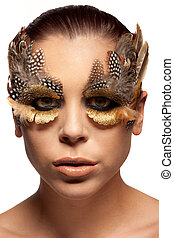 Woman wearing creative feather make-up