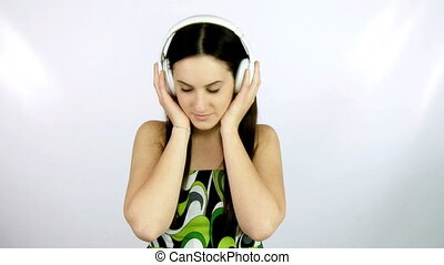 Girl listening music with headphone - young girl listening...