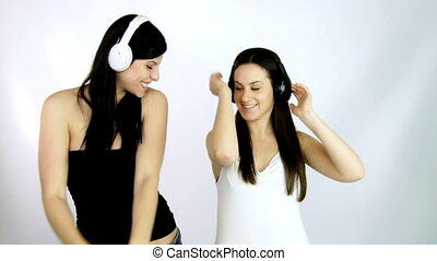 girls dancing happy listening music
