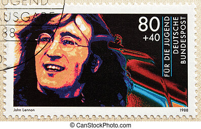 John Lennon - GERMANY - CIRCA 1988 A postage stamp printed...