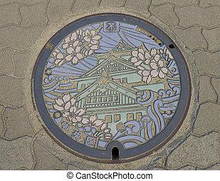Sewer manhole with Osaka castle picture - Sewer manhole...