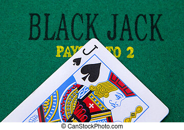 black jack with red poker chips in the background