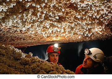 Cave stalactites - Beautiful stalactites in a cave with two...