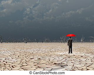 Man with red umbrella in dry land under gathering storm