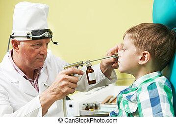 Little boy at ear nose thoat doctor - Medical...