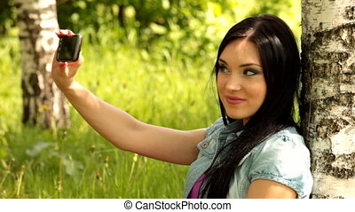 young female mobile - Pretty young female having a...