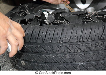 exploded truck tire - changing the tire of a truck after...