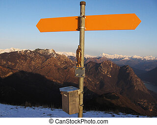 Orange singboard on mountain peak
