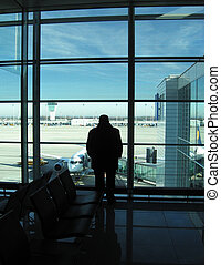 Men in airport - Male silhouette in the waiting lounge in...