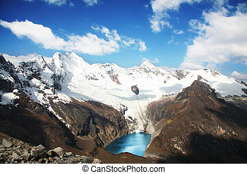 Lake in Cordilleras - Snowcovered high mountain in...