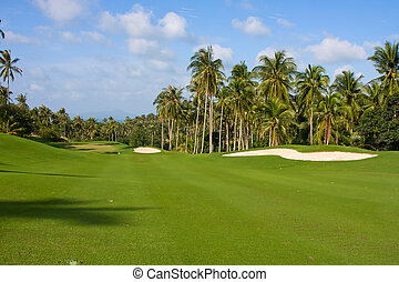 Landscape of a beautiful green golf course with sky. Island...