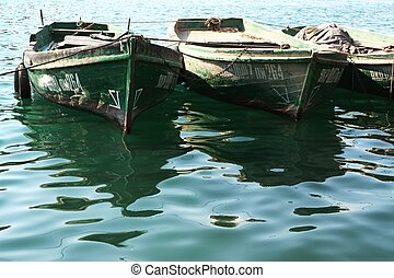Green boats at the port