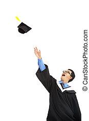 happy graduating student throwing the  cap