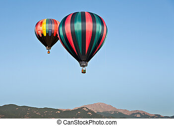 Hot Air Balloons Over Pikes Peak - A hot air balloon ascends...