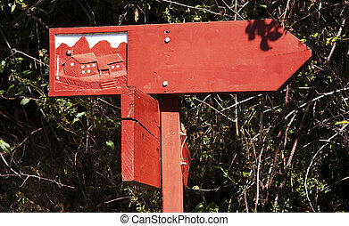 Red singboard on trail-way