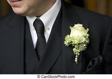 man in black suit with white rose buttonhole - man at a...