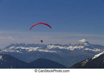 paraglider over the mountains (red)