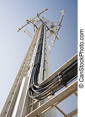 Antenna - A communication antenna towers above equipped with...