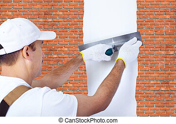 Mature contractor - Wall of a house from a brick. Mature...